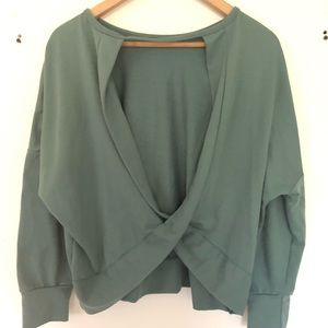 Green sweater with back cut out size large